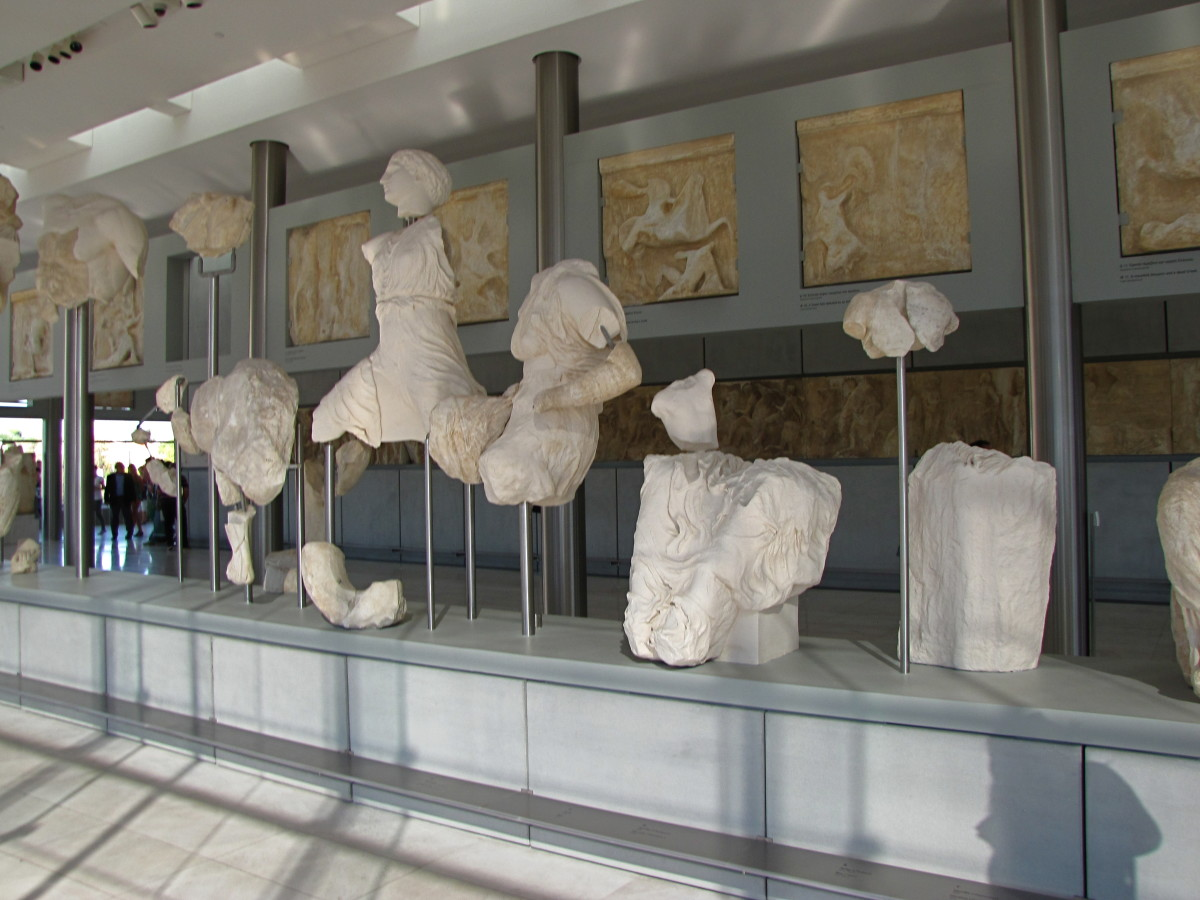 Foreground - Pediment Sculptures.  Above and behind - Metopes.   Below and behind - The Frieze Blocks.   All laid out exactly as they appeared on the Parthenon