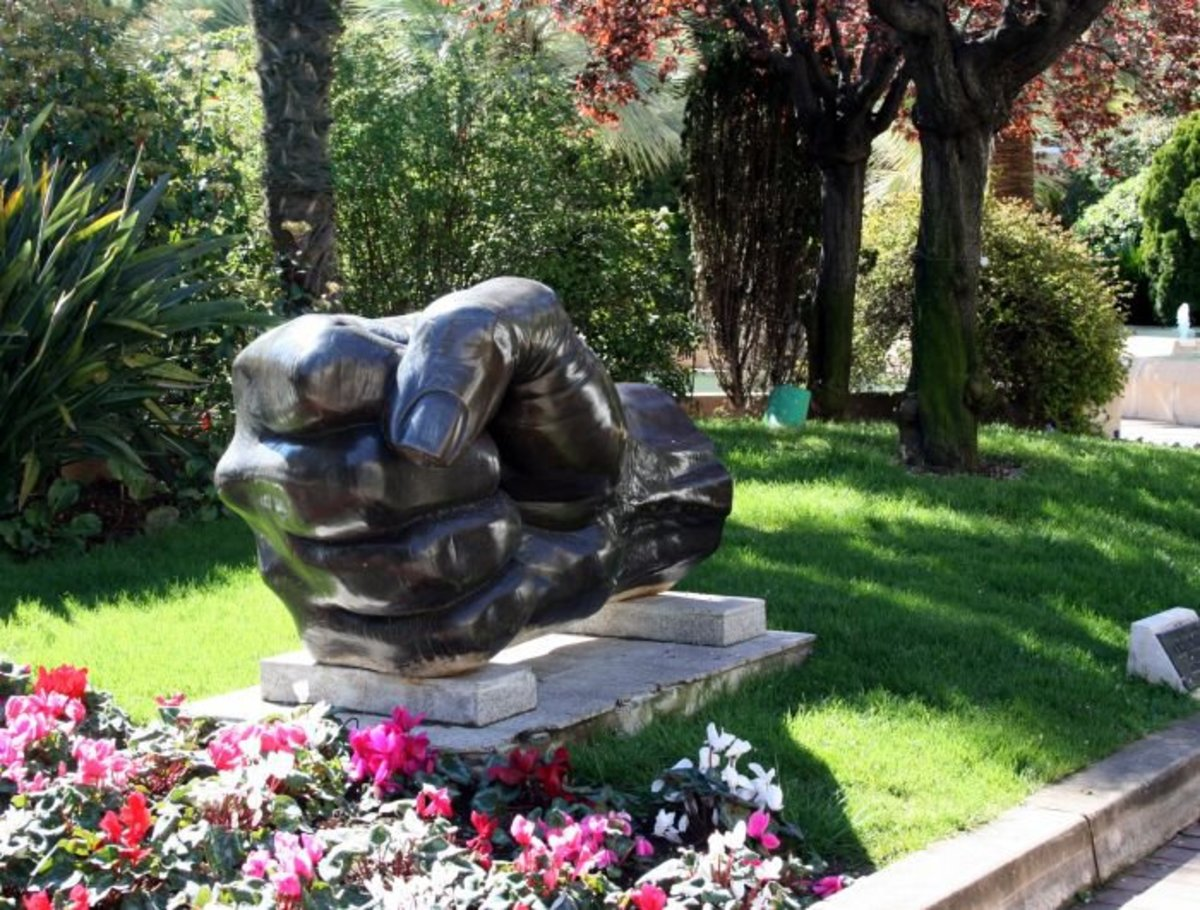 A sculpture of a closed fist, Le Poing by Cesar, 1980