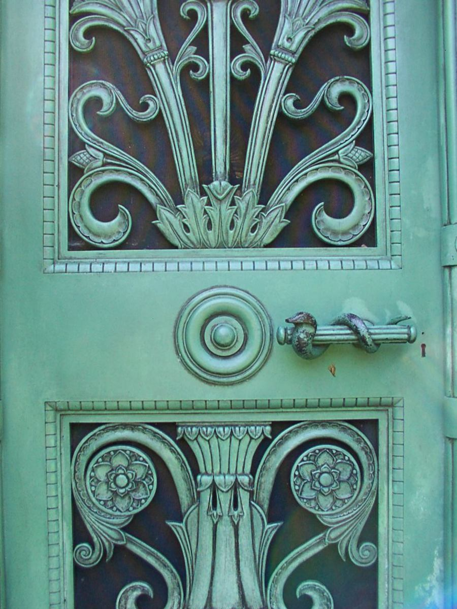 Close up of the Schoenhofen tomb door which shows sylized Egyptian lotus and serpent door handle.