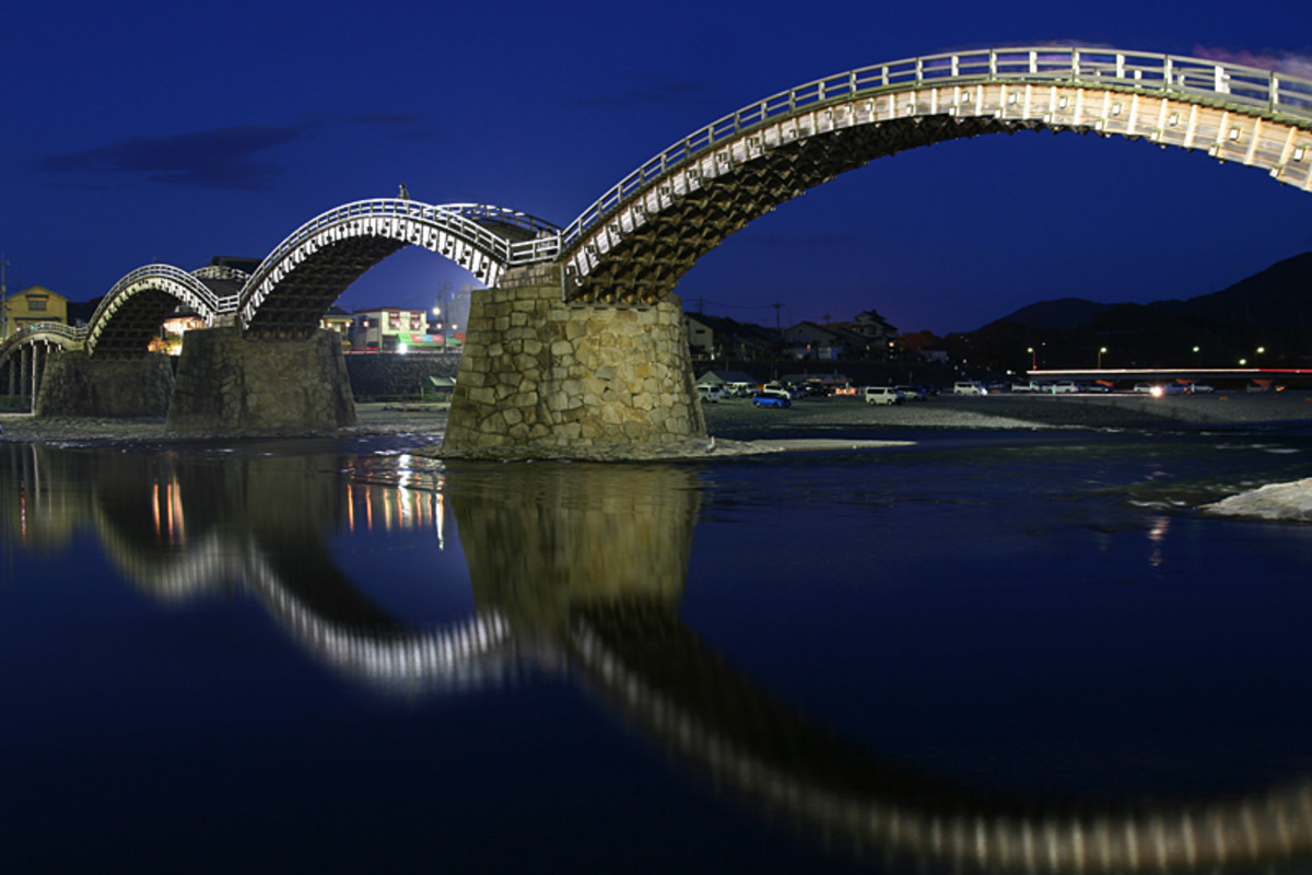 Kintai Bridge displays fine traditional Japanese wood craft. The nighttime illumination combined with the reflection from the river leave a lasting impression.