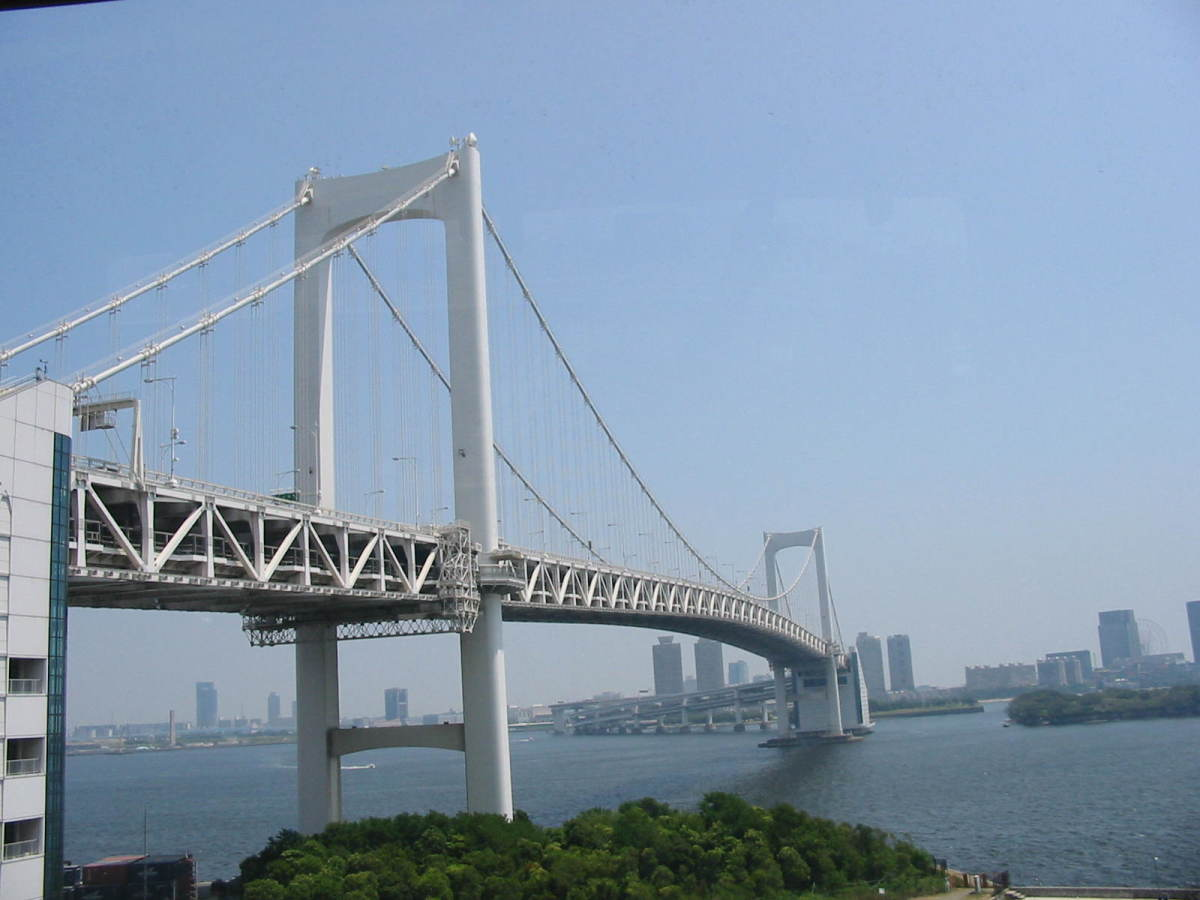 Rainbow Bridge, painted white to harmonise with the Tokyo skyline, viewed from the mainland side.