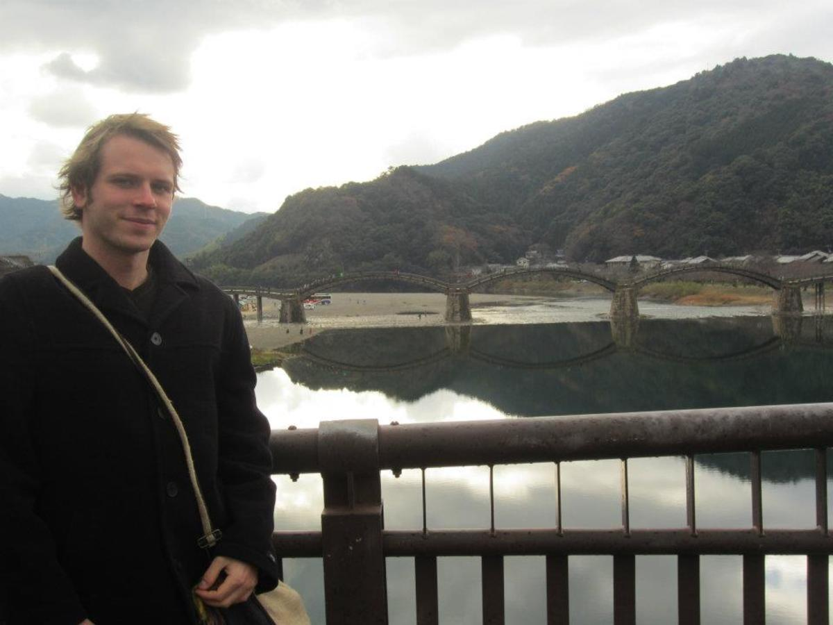 The author of this article, Ciaran, standing beside Kintai bridge, a Japanese national treasure and popular tourist destination.