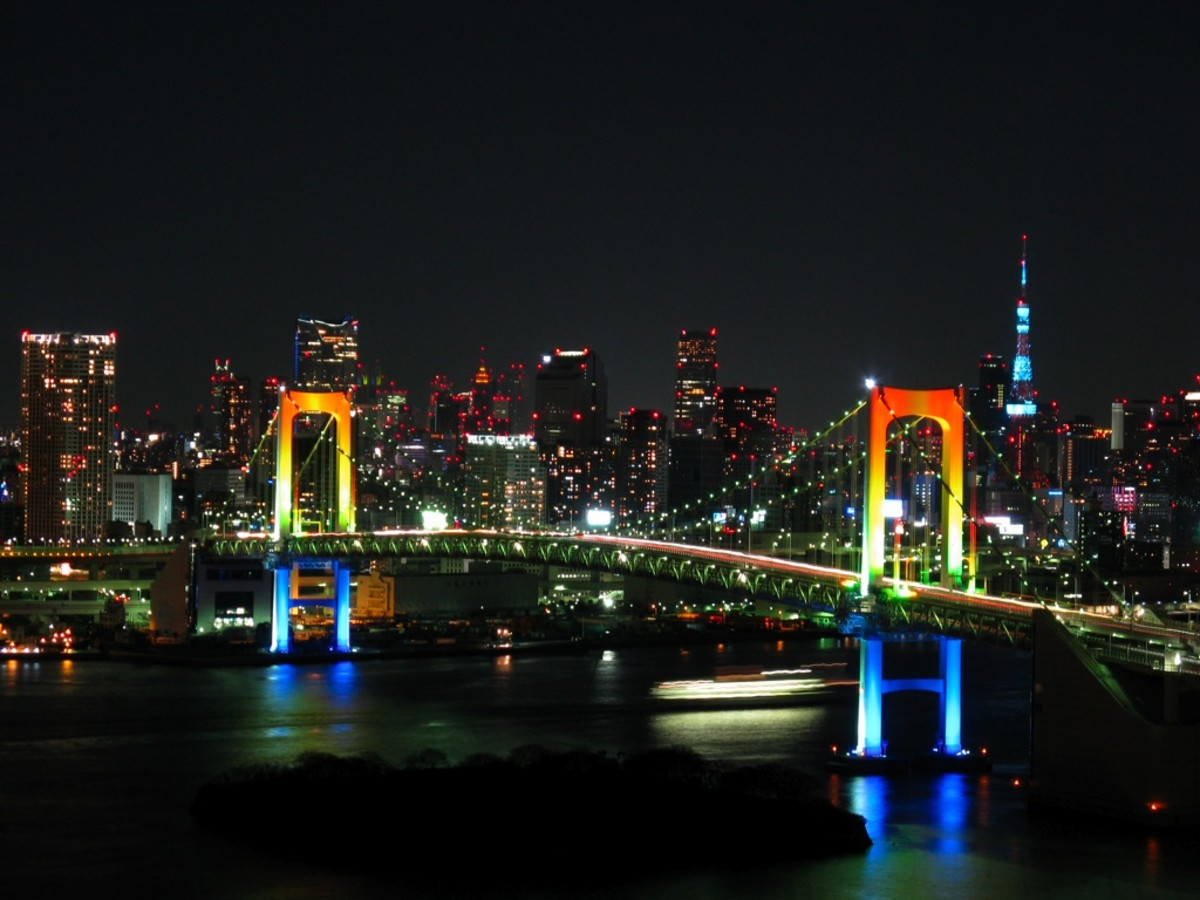 Displaying its namesake, rainbow bridge is illuminated at night using red, green and white lamps, powered by solar energy obtained each day.