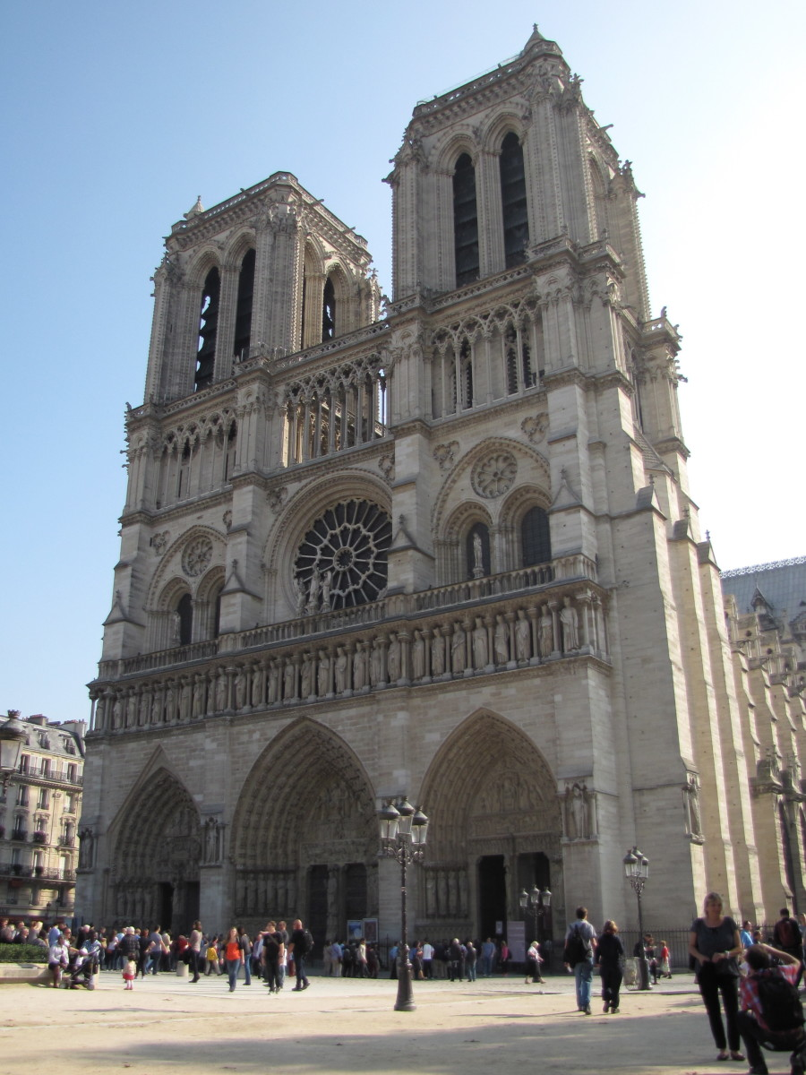 Notre Dame from the front:  the three portals, gallery of the kings, exterior of the west rose window and the twin towers.