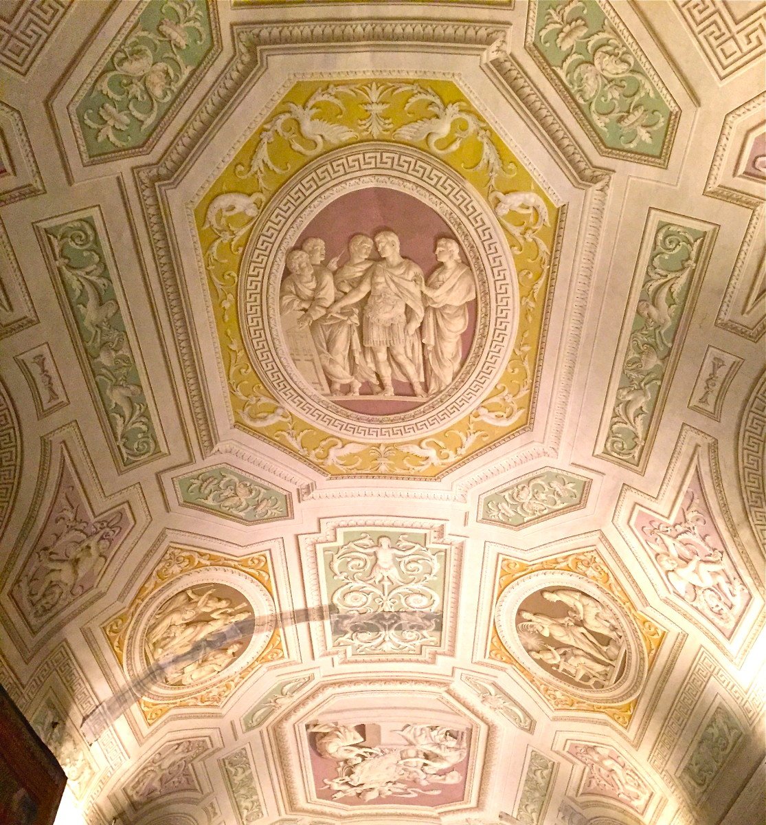 A ceiling in the Vatican Museums gives the illusion of a carved bas relief, however it is actually flat painting using painted shadows to give the illusion.