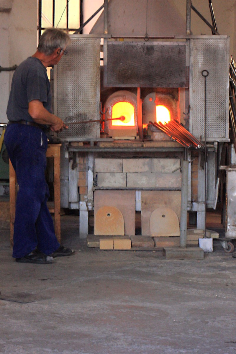 An exhibition of glass manufacture in one of the furnaces open to public viewing