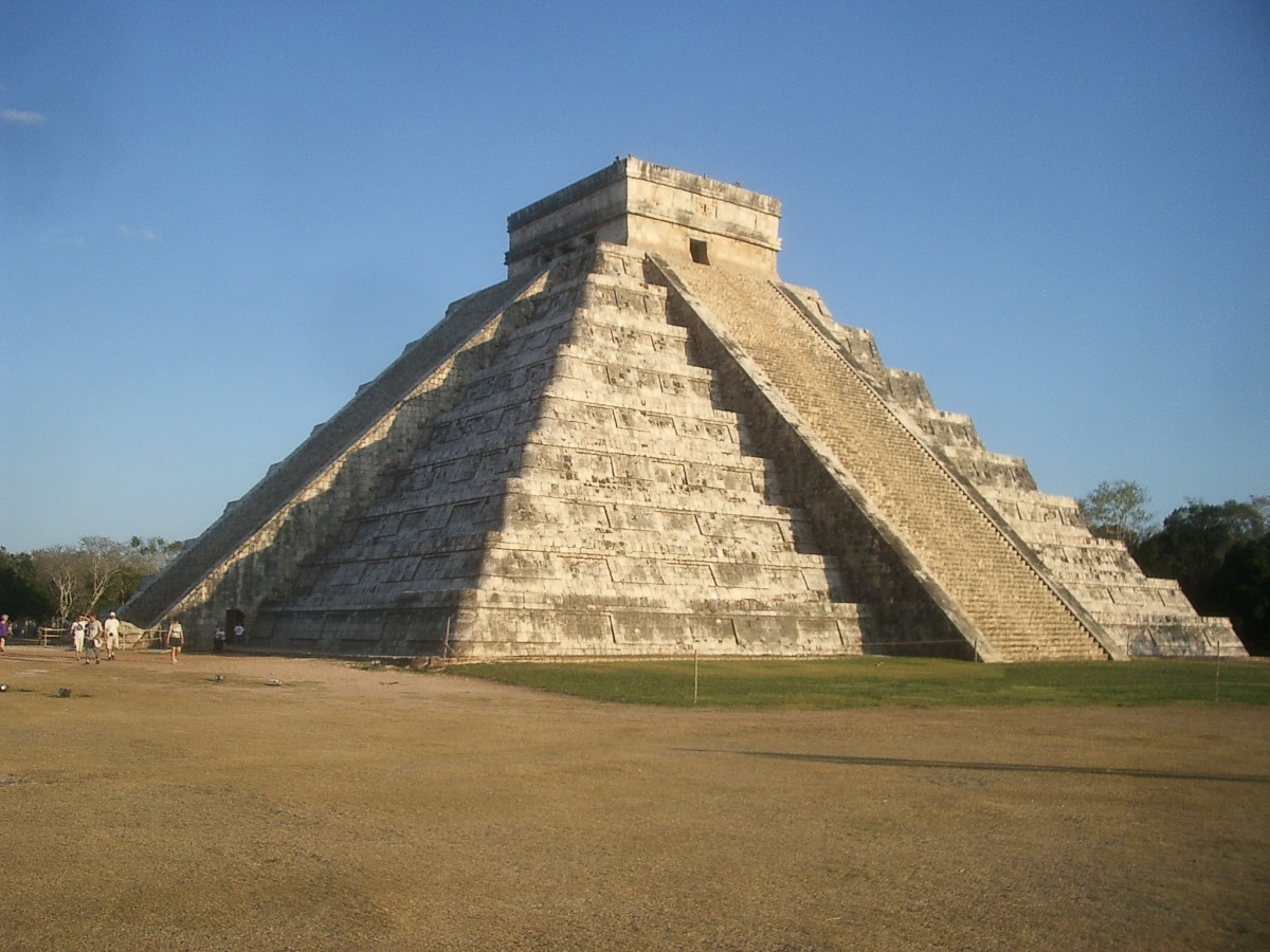 """The Serpent Kukulcan """"descending"""" the stairs of El Castillo in Chichen itza, at sunset, a few days after the spring equinox."""