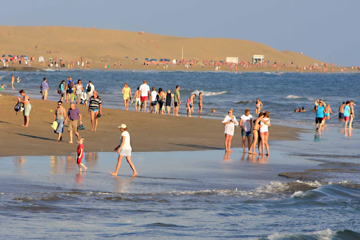 One of the great dunes rises above the beach of Playa de Maspalomas