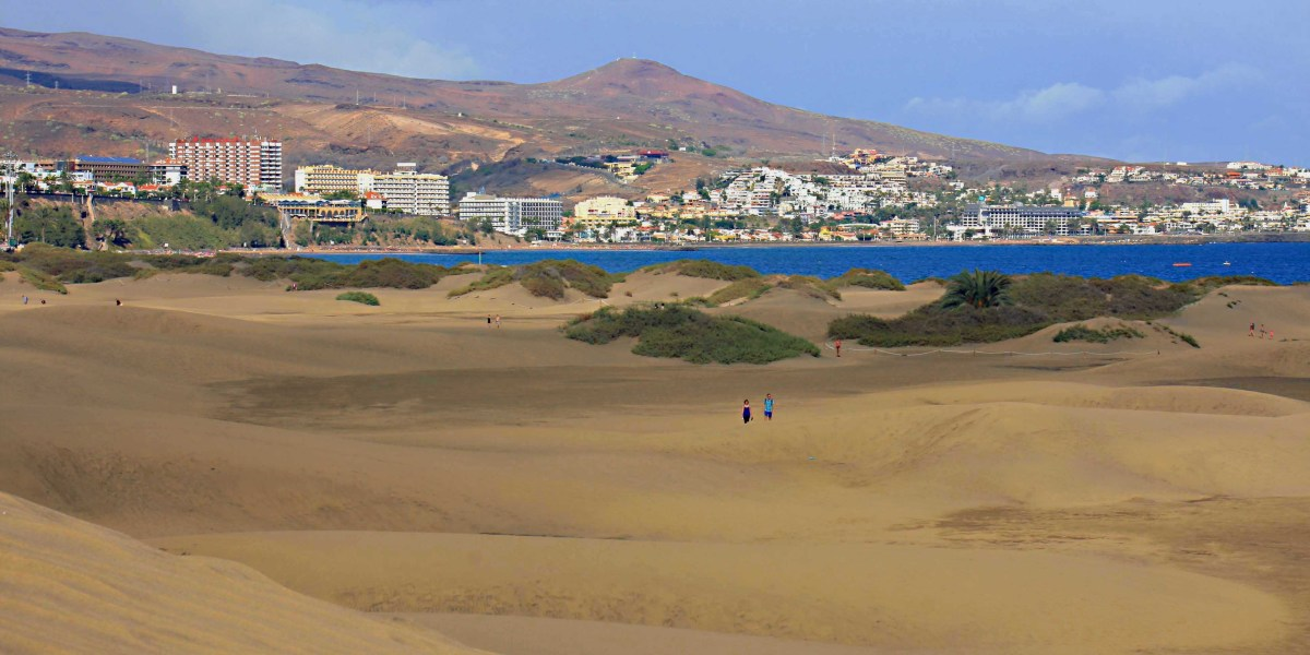 Across the dunes to the east - the beach resort of Playa del Ingles