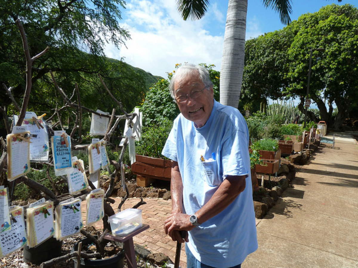 "Mr. Moriso Teraoka next to his ""poet"" tree"