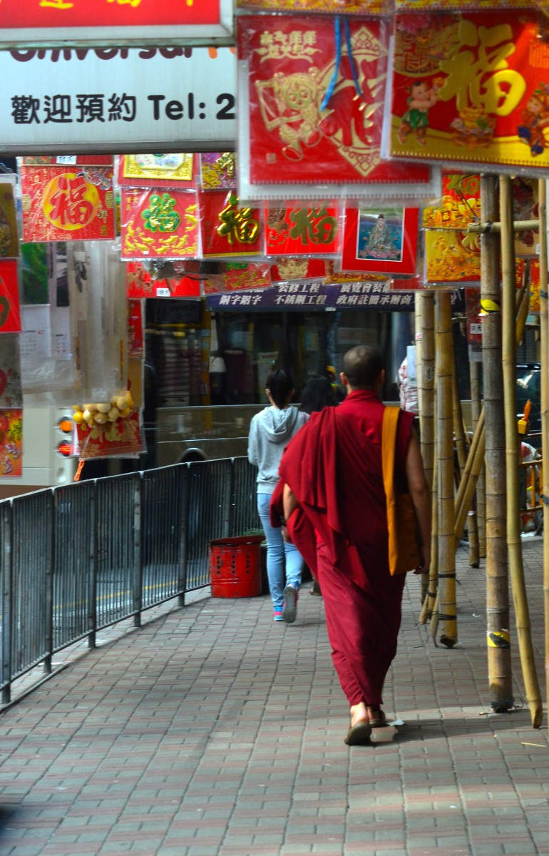 A monk walking the streets of Hong Kong (c) A. Harrison
