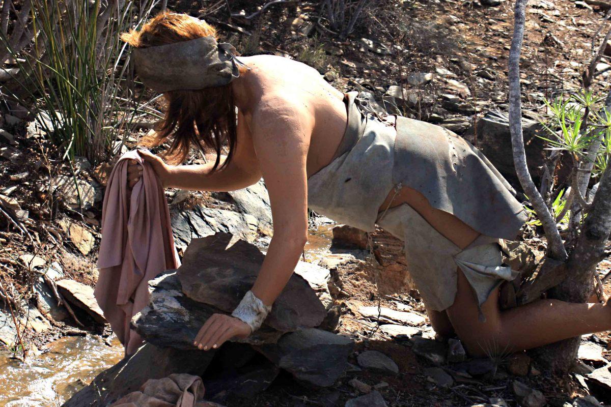 A Guanche woman washing clothes