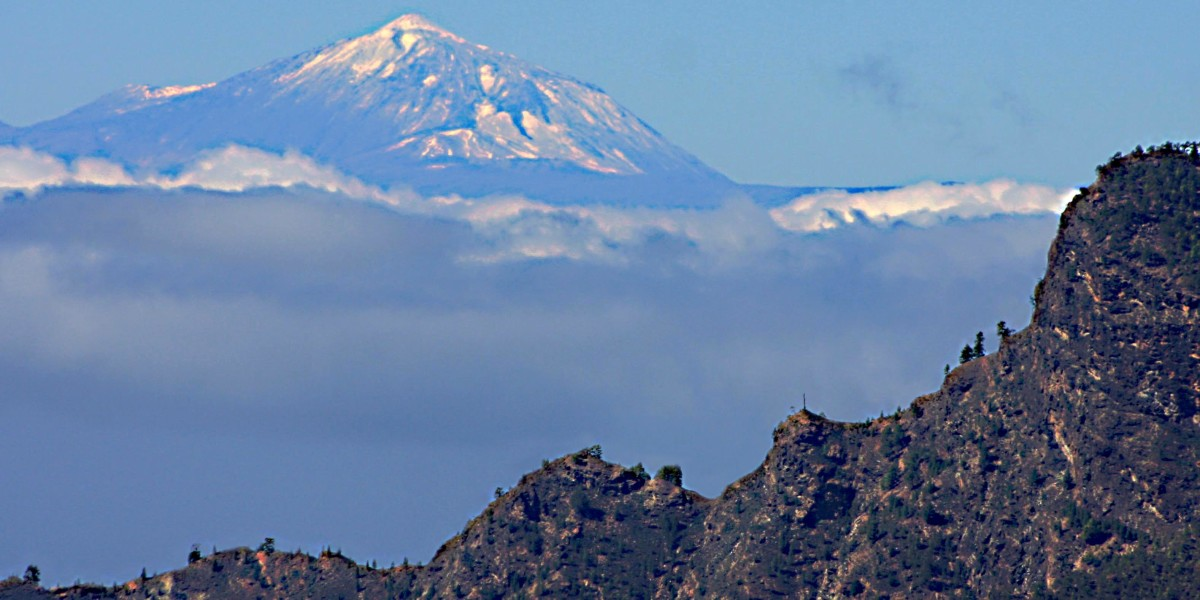Two islands in one photograph - Gran Canaria and Tenerife. In this image, Mt Teide is about 100 kilometres (62 miles) distant - the Atlantic Ocean which separates the two islands, is lost beneath the clouds