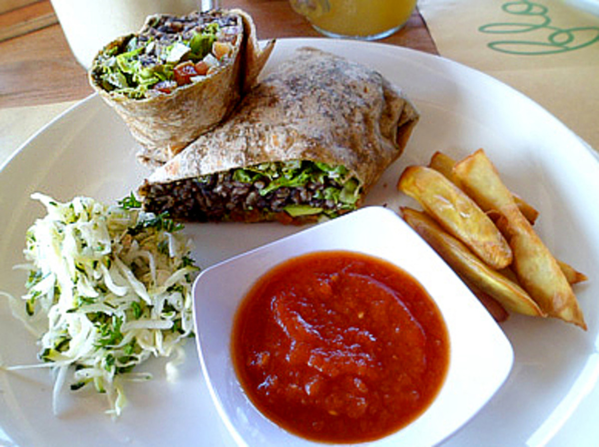Down To Earth's Almost Perfect Burrito: brown rice, black bean, avocado, baked tofu, veggies, served with tomato salsa, sprouts, and fries.