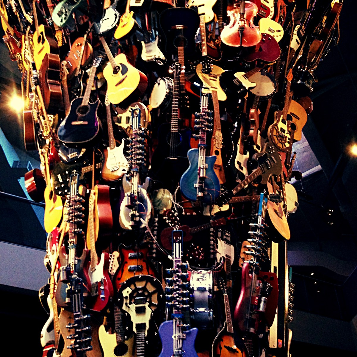 The guitar sculpture hanging from the ceiling of the EMP museum in Seattle, Washington.  I cannot begin to count how many instruments make up this amazing art piece.