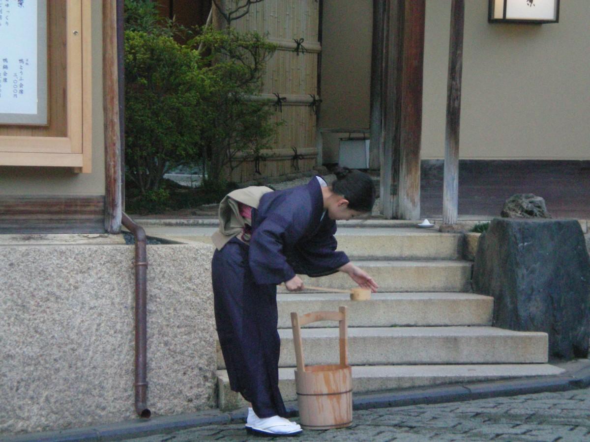 A trainee geisha busy with her chores (c) A. Harrison