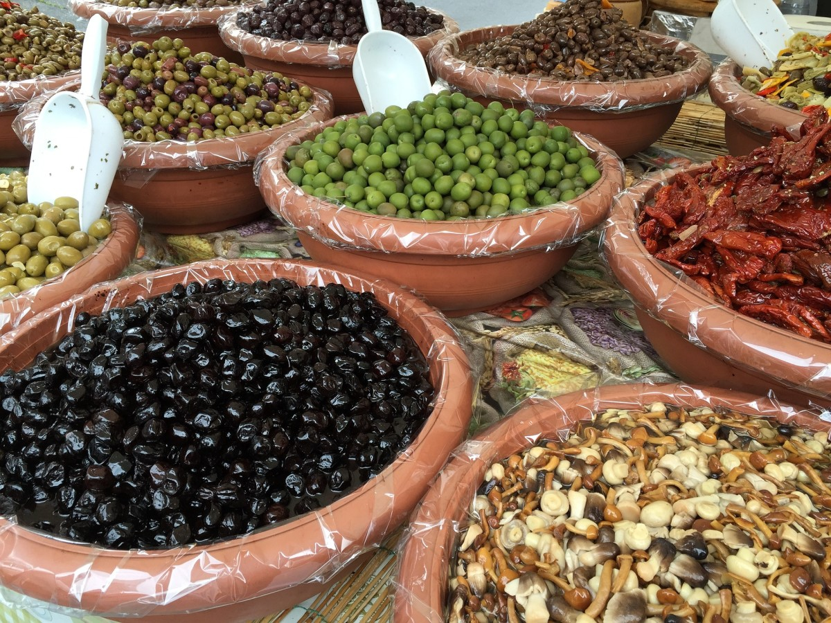 An assortment of olives at the farmers market