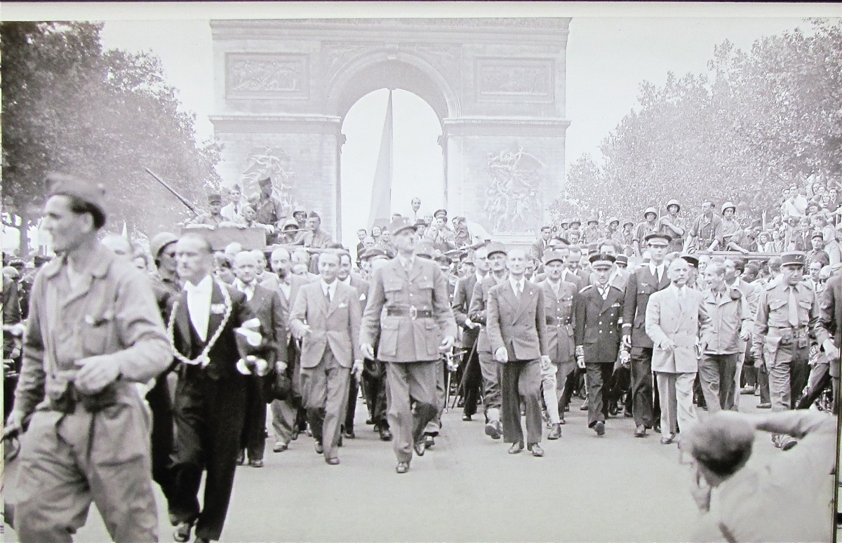 Charles de Gaulle marching under the Arc de Triomphe and down the Champs-Elysees following the liberation of Paris in WWII.