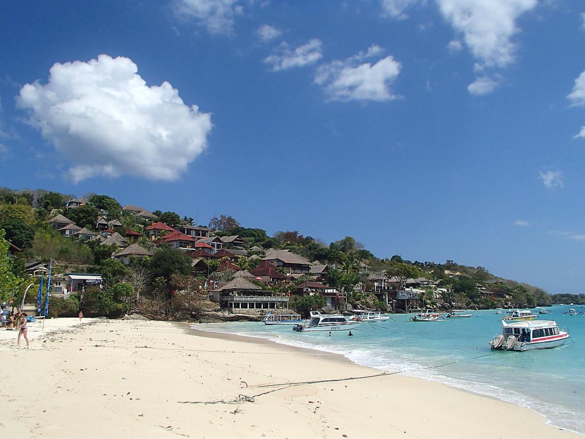 Vacation resorts on limestone cliff above Jungut Batu Beach.