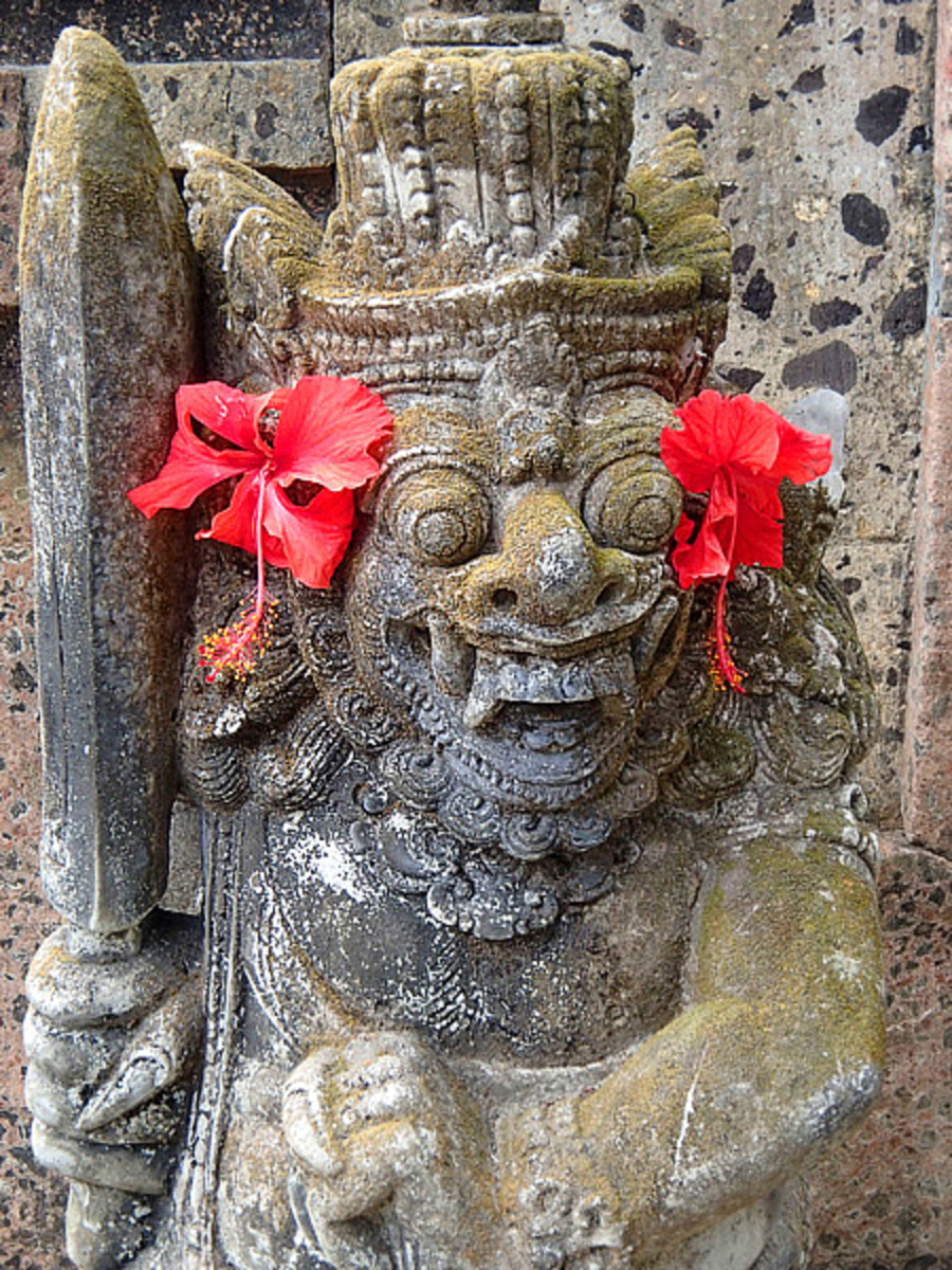 Statue of mythological creature guarding the gate of a Hindu temple.