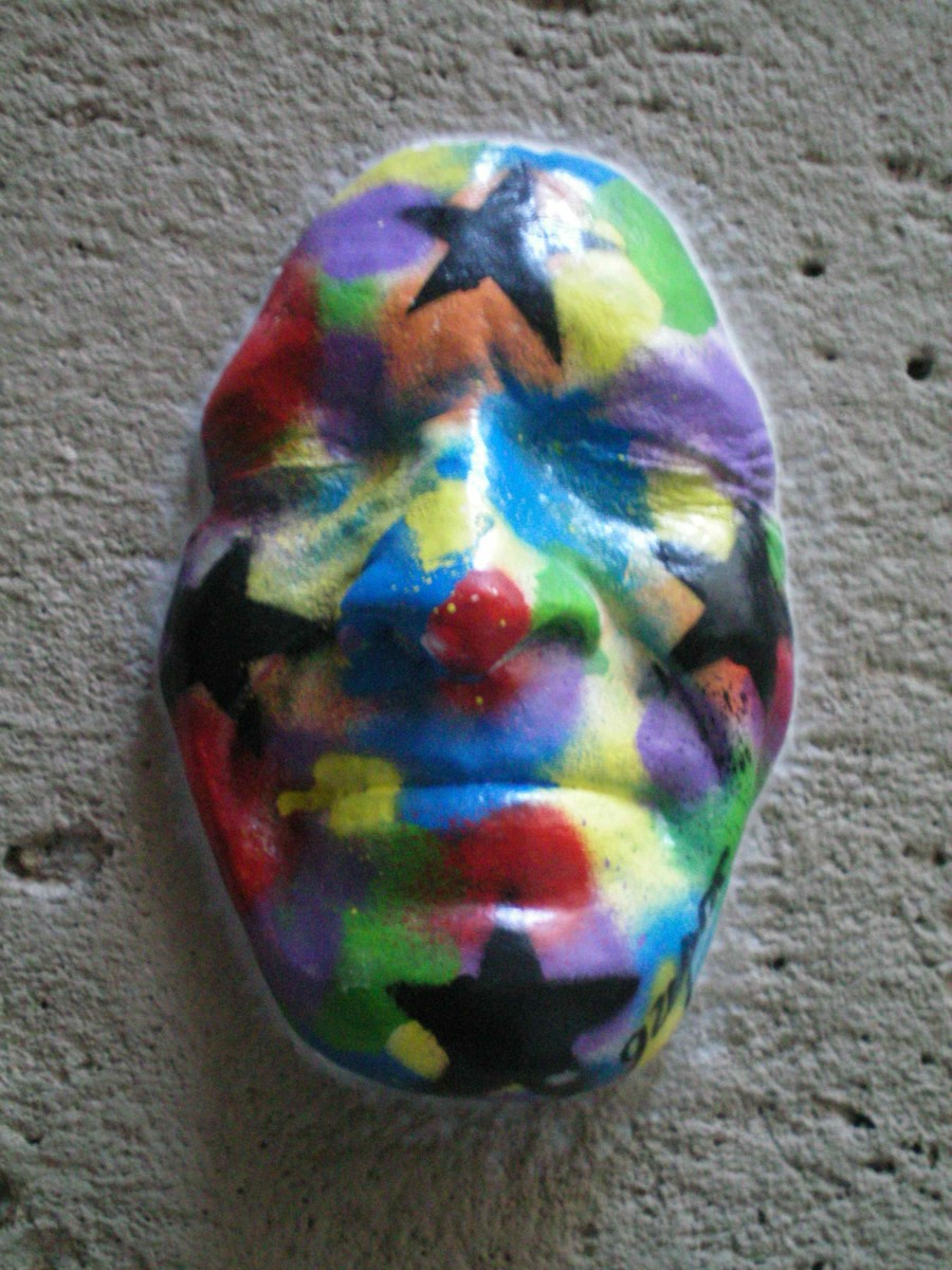 A mask decorating a side street (c) A. Harrison