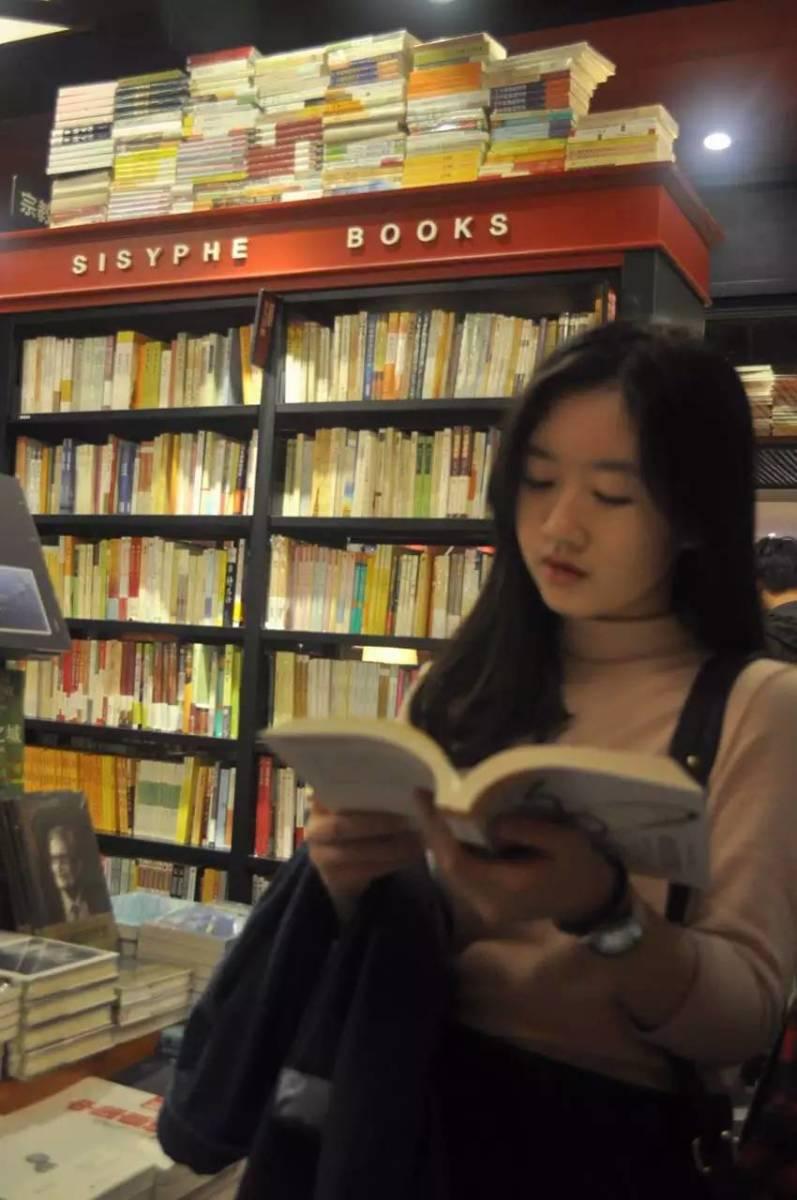 Girl reading in Sisyphe Books