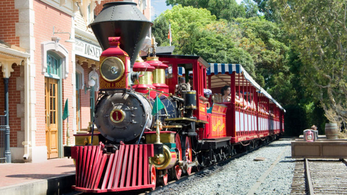 The Disneyland Railroad, featuring 5 of the world's only remaining steam powered locomotives, takes guests on scenic route around the entire park and ending with a trip through the Prehistoric Grand Canyon (featuring animatronic dinosaurs).