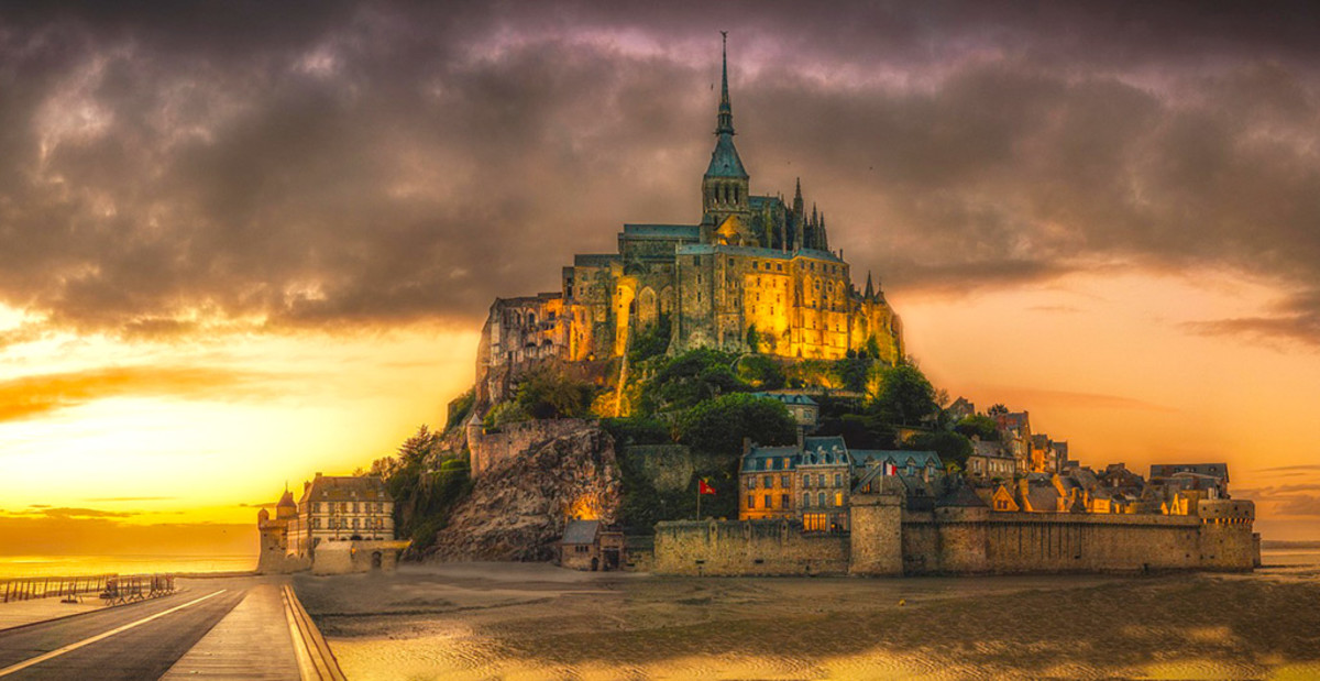 The surreal Mont St Michel at sunset.