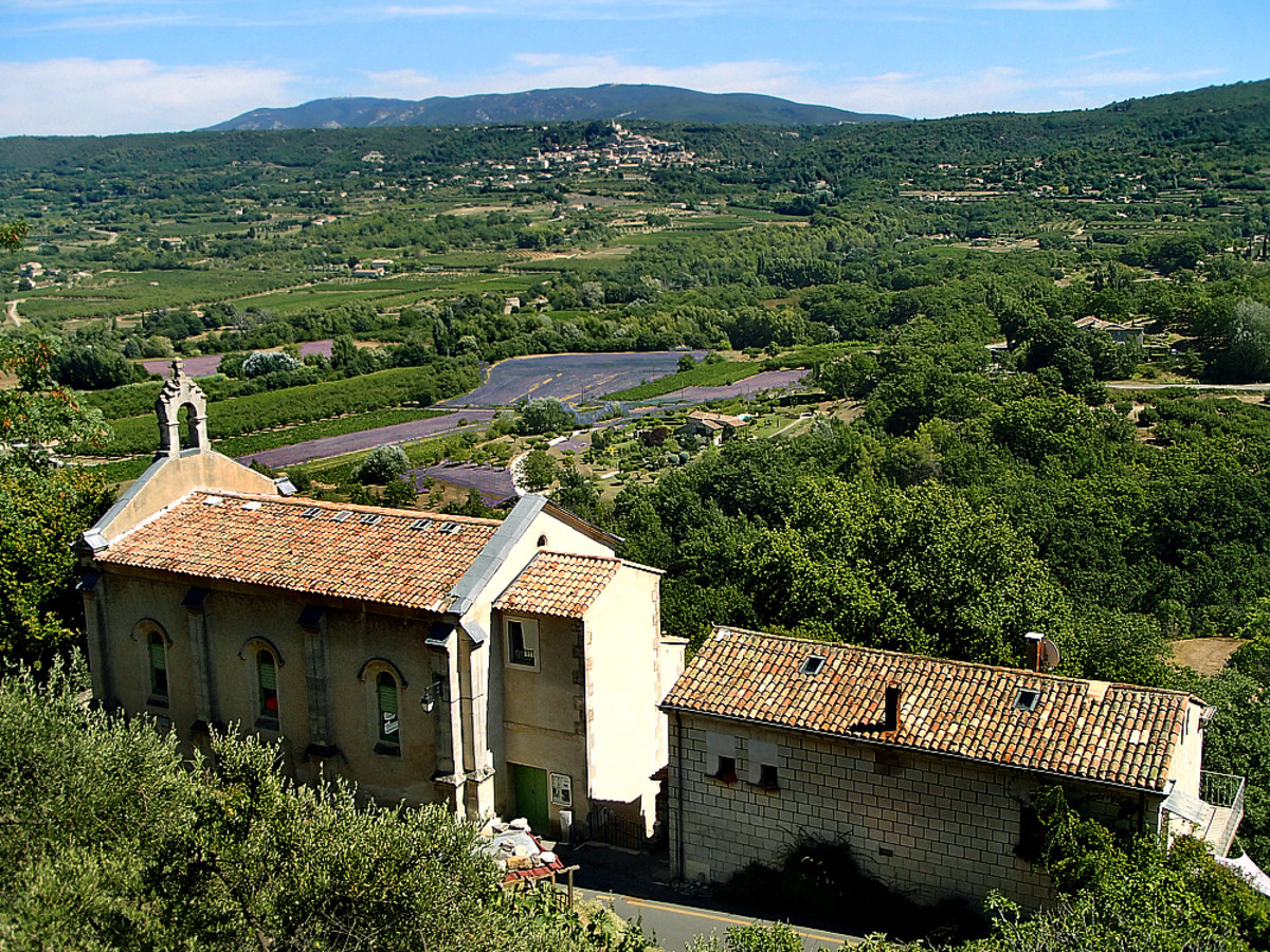 Sweeping views of Provence countryside from Lacoste village on biking route.