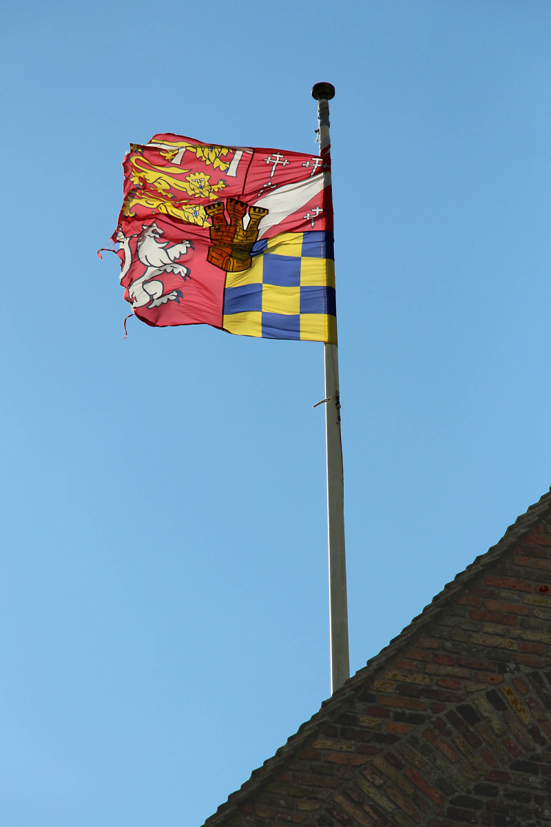 England's flag doesn't fly here - it's the Coat of Arms of the Howard family. Henry VIII sold Castle Rising to Thomas Howard, Duke of Norfolk in the 16th century
