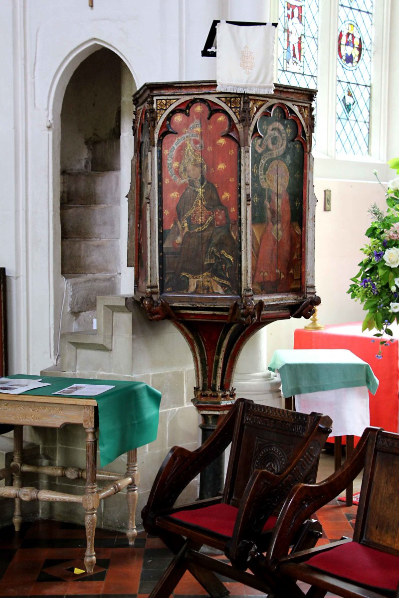 The 15th century wineglass shaped pulpit features depictions of saints