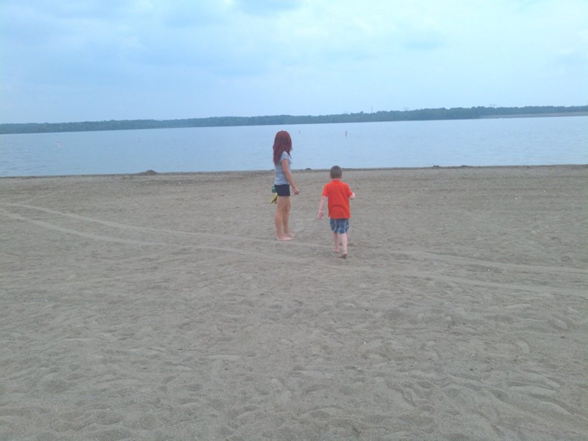 My son and I enjoying a walk on the beach at Alum Creek State Park.