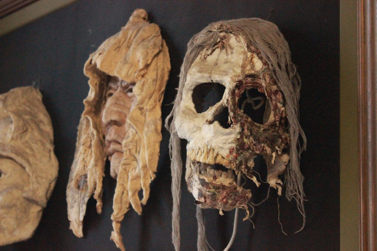 Masks made by an inmate of the Penitentiary; they hang near the ticket counter at the museum.