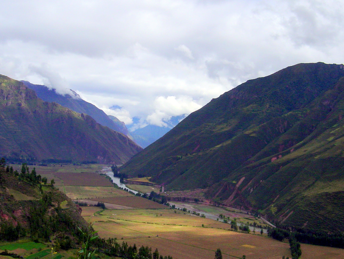 The beautiful Urubamba River Valley winds through the mountains, down from the Andes, where it carved the saddle between peaks where Machu Picchu was built by the Incas.