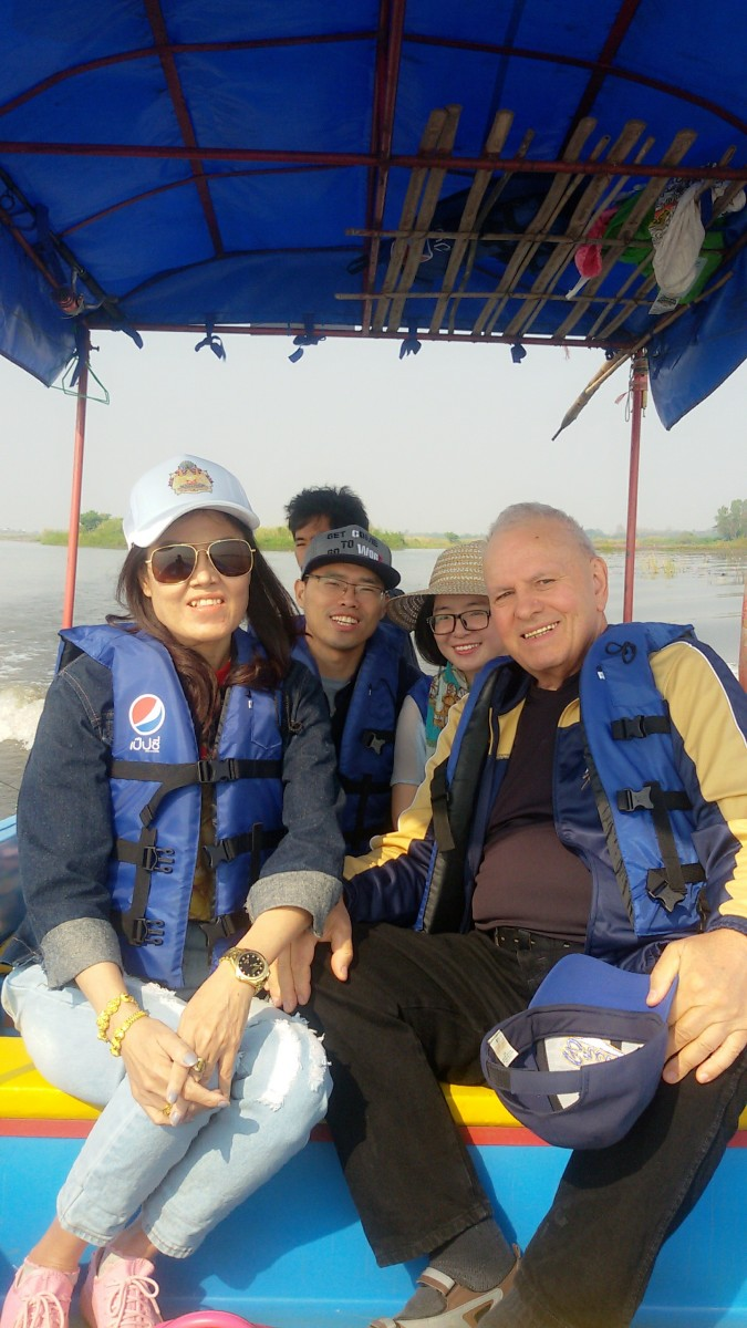 Author pictured next to wife on a boating excursion with friends in Thailand.  Picture taken in February 2018.