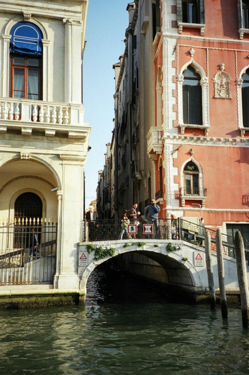 A small bridge over a canal, with interesting architectural touches on the adjacent buildings