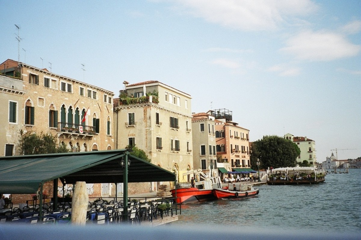 Boats, hotels and empty restaurants line the Grand Canal, prepared for the rush of the evening meal.