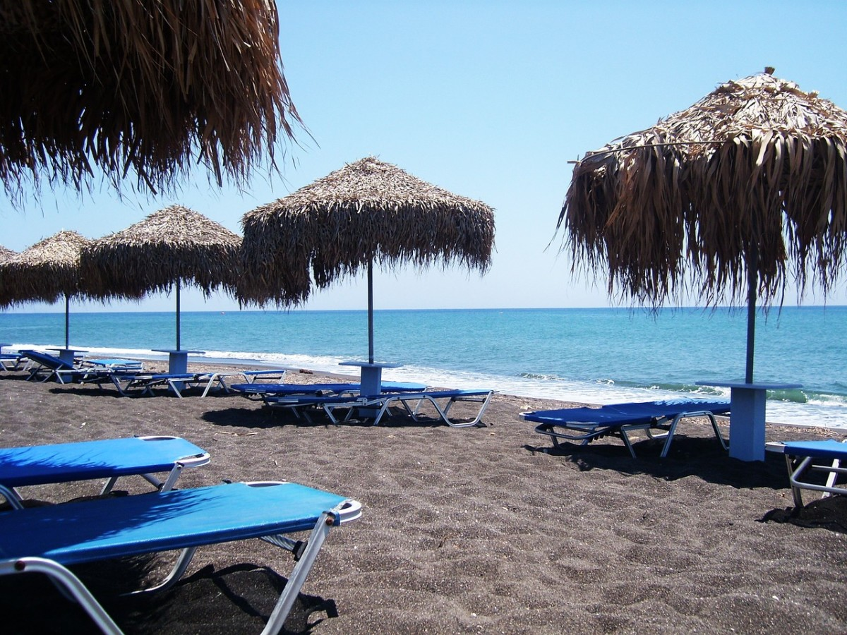 Santorini's beaches are hot, black, volcanic sand