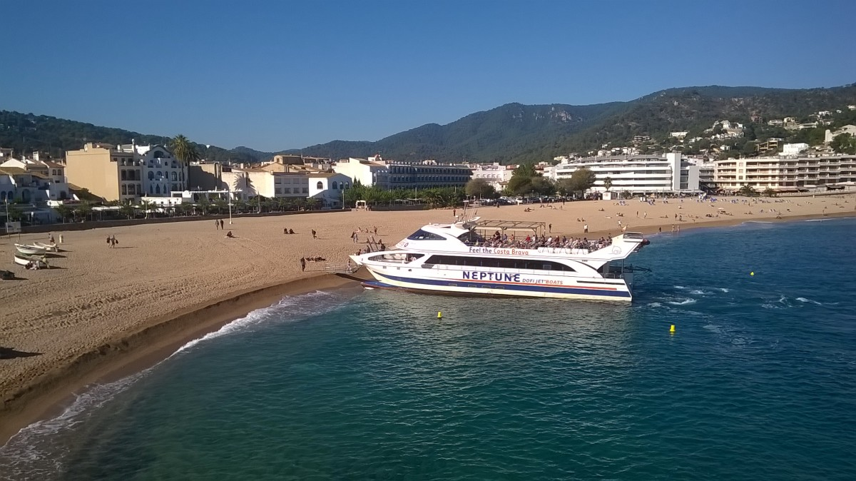 Catch a boat all the way from Calella to Tossa de Mar