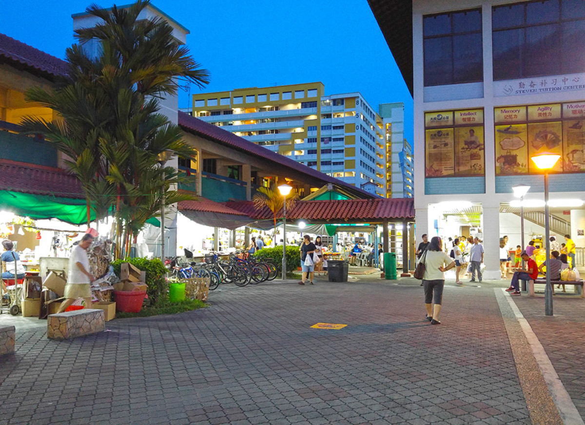 A Singaporean neighborhood center at evening time. Lots of bargains can be found at such places.