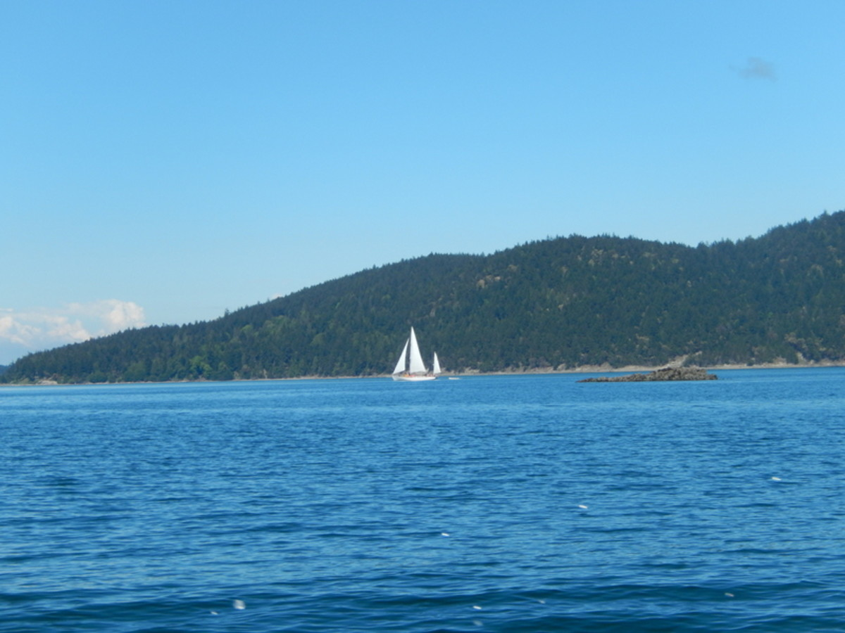 Elegant sailing vessels ply the waters of Rosario Strait, but if you're in your own power boat, remember sailboats have the right of way.