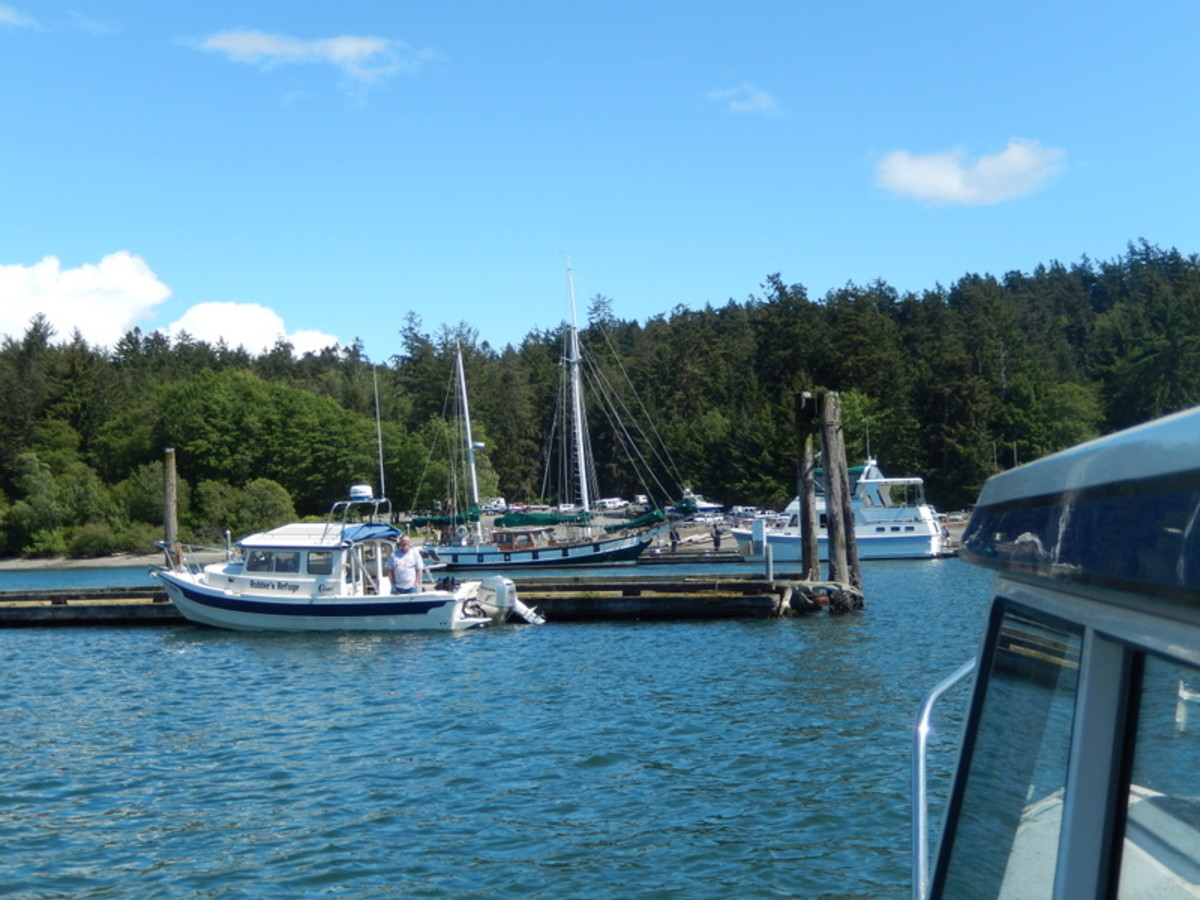 Our companion from the trip over to Friday Harbor awaited us in his 22' C-Dory, alongside a vintage sailboat and a classic cabin cruiser at the dock in Cornet Bay, a nice welcome after our memorable mini-cruise in the Pacific.