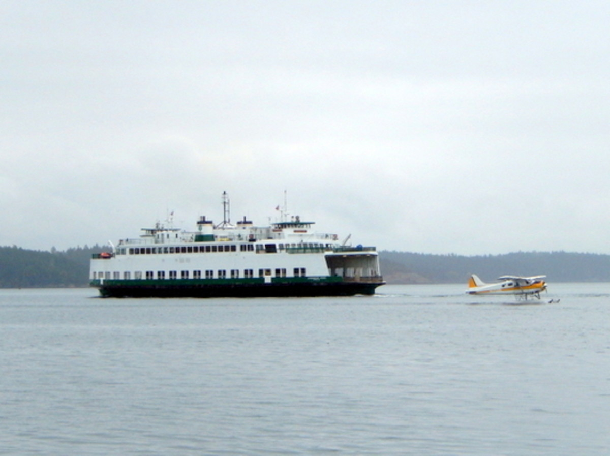 A Washington State ferry and a seaplane nearing the Port of Friday Harbor.