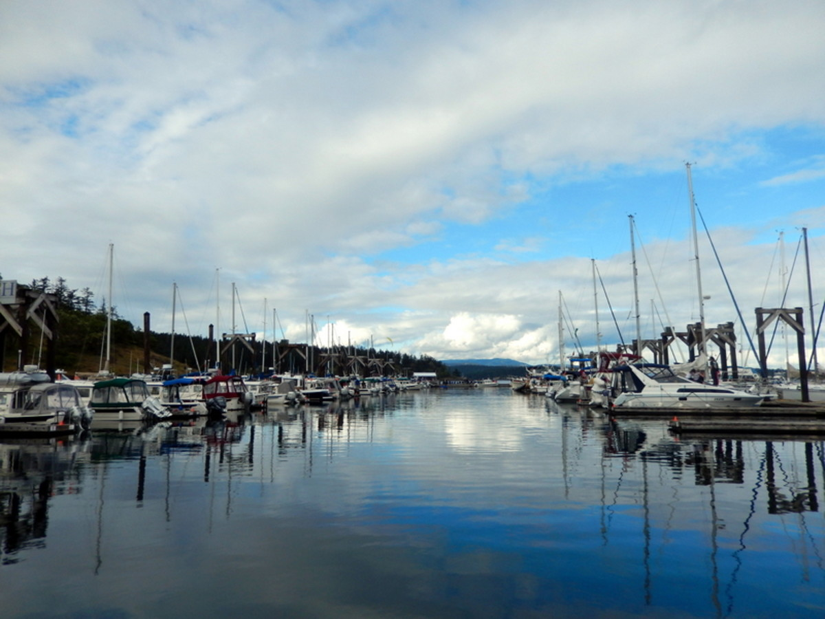 The lines of privately owned boats--in this case, C-Dories on the left, large yachts on the right--are highlighted by the flat, barely rippled water reflecting the vivid sky over Friday Harbor Marina.