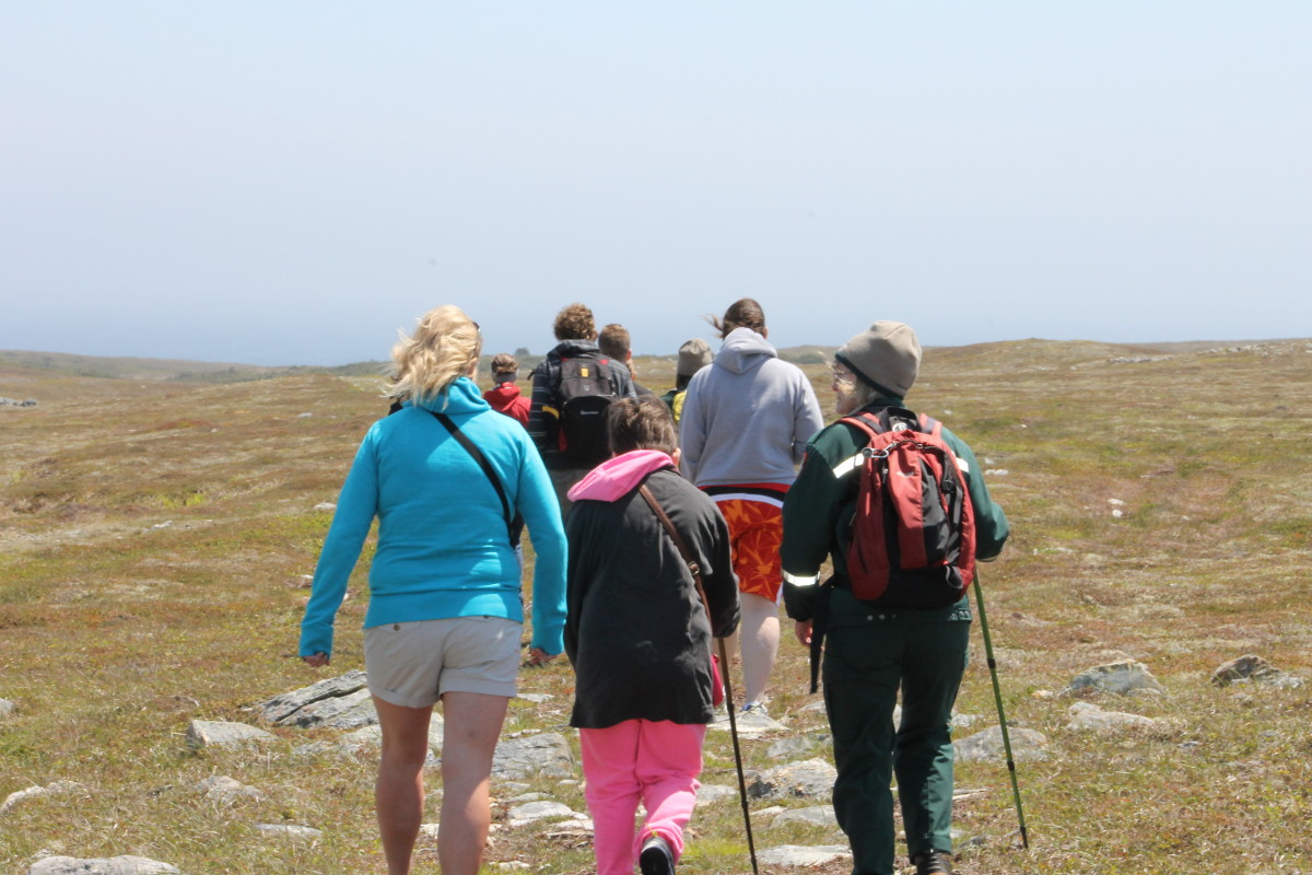 Tour Group with guide on trail to Mistaken Point.