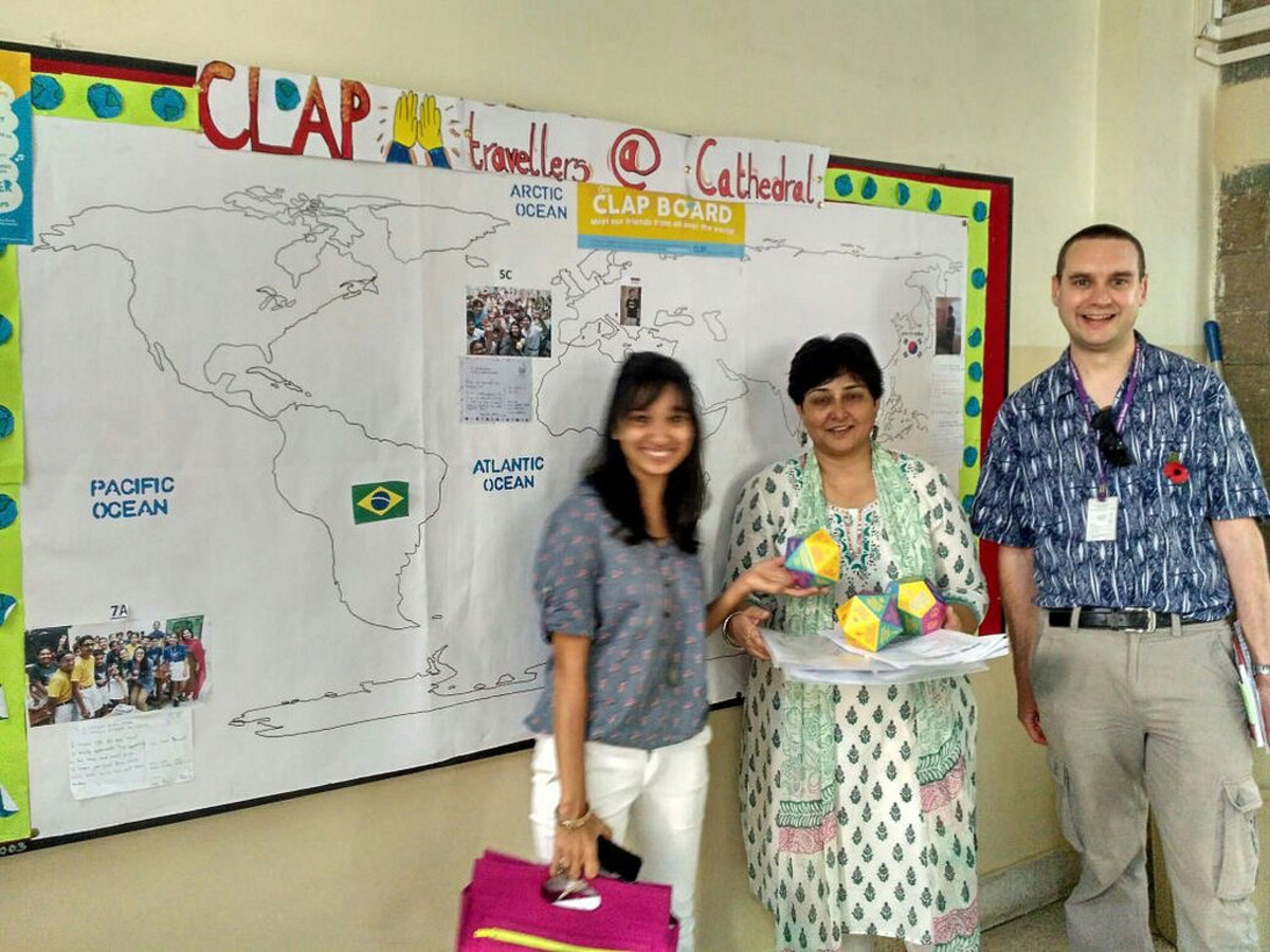 L-r: Clap Global founder Shirin Johari, teacher Ms Seema and me next to a map showing where Clap Talk travellers are from.