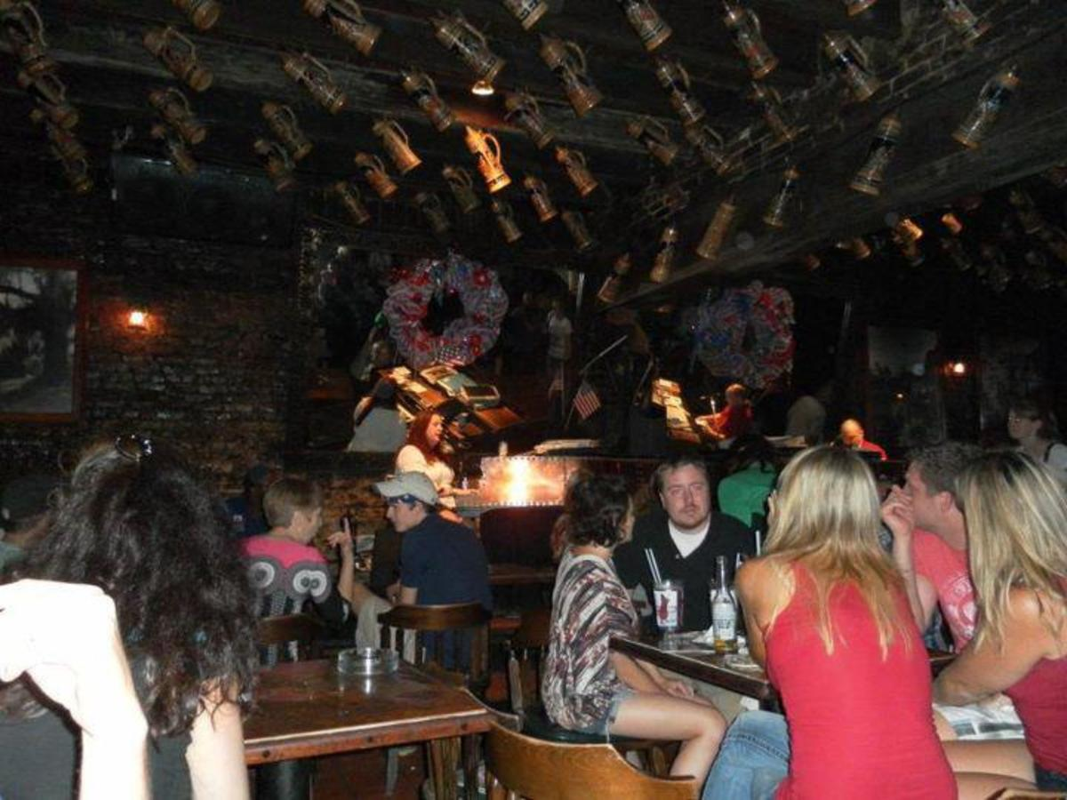 Pat O'Briens Bar is an outdoor hangout with a flaming fountain, connected to the bar which includes live piano music