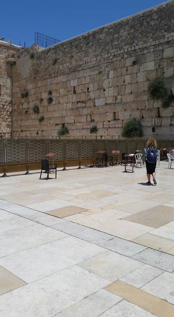 The Western Wall is located in Jerusalem.  Here, you can write a prayer on a piece of paper and put it in the wall.  This is one example of an area where men and women are separate.