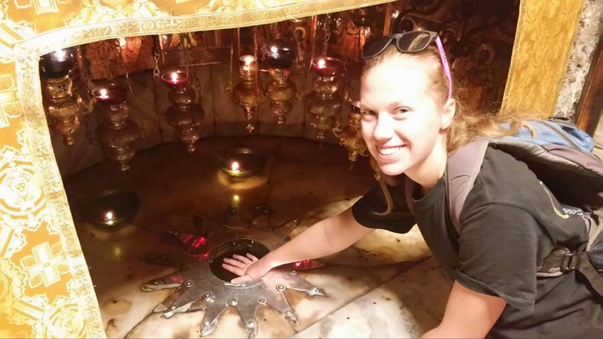 It is claimed that the rock I am touching is in the cave where Jesus was born.  I don't know if it's true, but it was still very cool.  This is located in Bethlehem.
