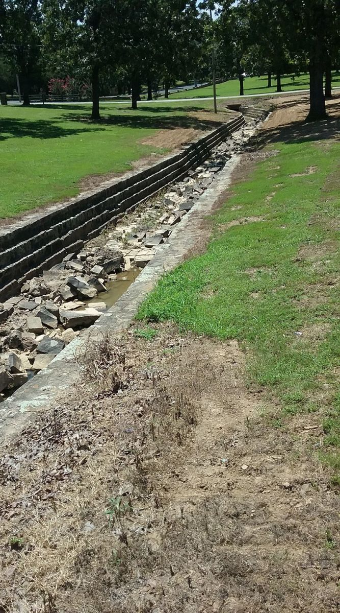 "WPA Ditch at Twyman Park.  The ""floor"" has seen better days, but the sidewalks and structure of the ditches are in amazing shape."